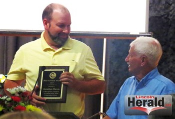 Johnathan Harris (left) receiving the Blair Goodson Conservation Award from Tommy Houser.(Photos Courtesy of Kirk Herbertson)