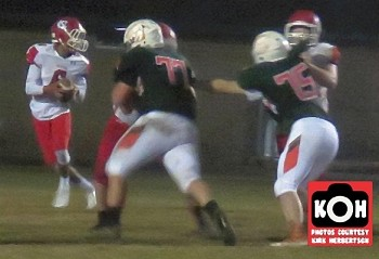 Newton-Conover's quarterback spent much of the night trying to get away from East Lincoln's Trent Smith (#77). Smith sacked him twice and then blocked a punt that led to a Mustangs touchdown a few plays later.