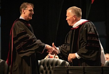 University provost Gary Johnston (left) presents honorary degree to Ted Goins Jr.(Photos Courtesy Mikeala Skelton, Lenoir-Rhyne University)