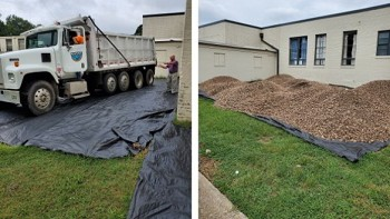 Mark Bolick from LeeBoy and Benny Proffitt of Midstate Contractors coordinated the delivery of rock from APTAR for the community garden in the Oaklawn Community.