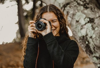 Dallas-based photographer Lindsey Choate takes aim for another picture. A nursing student, Choate is also making quite a name for herself as a shutterbug.(Photos Courtesy of Lindsey Choate)