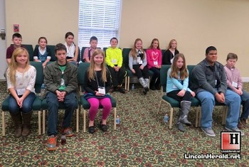 The 14 students who won at their individual schools waiting for the Spelling Bee to begin.